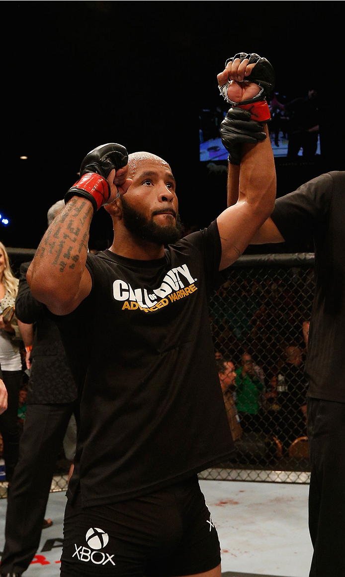 LAS VEGAS, NV - SEPTEMBER 27:  UFC Flyweight champion Demetrious Johnson celebrates after his win over Chris Cariaso after their flyweight championship fight during the UFC 178 event inside the MGM Grand Garden Arena on September 27, 2014 in Las Vegas, Ne
