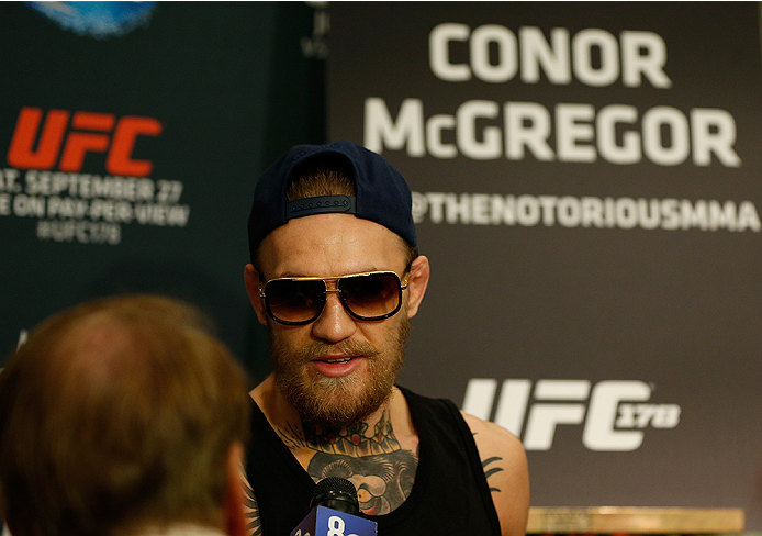 LAS VEGAS, NV - SEPTEMBER 25:  Conor McGregor of Ireland interacts with media during the UFC 178 Ultimate Media Day at the MGM Grand Hotel/Casino on September 25, 2014 in Las Vegas, Nevada. (Photo by Josh Hedges/Zuffa LLC/Zuffa LLC via Getty Images)