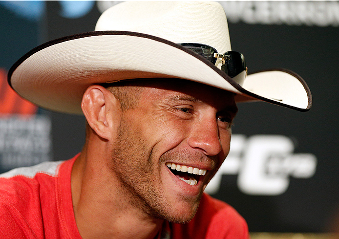 """LAS VEGAS, NV - SEPTEMBER 25:  Donald """"Cowboy"""" Cerrone interacts with media during the UFC 178 Ultimate Media Day at the MGM Grand Hotel/Casino on September 25, 2014 in Las Vegas, Nevada. (Photo by Josh Hedges/Zuffa LLC/Zuffa LLC via Getty Images)"""