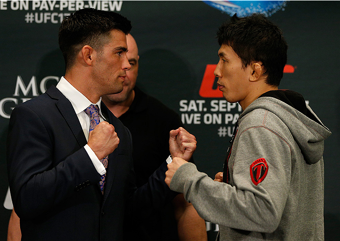 LAS VEGAS, NV - SEPTEMBER 25:  (L-R) Opponents Dominick Cruz and Takeya Mizugaki of Japan face off during the UFC 178 Ultimate Media Day at the MGM Grand Hotel/Casino on September 25, 2014 in Las Vegas, Nevada. (Photo by Josh Hedges/Zuffa LLC/Zuffa LLC vi