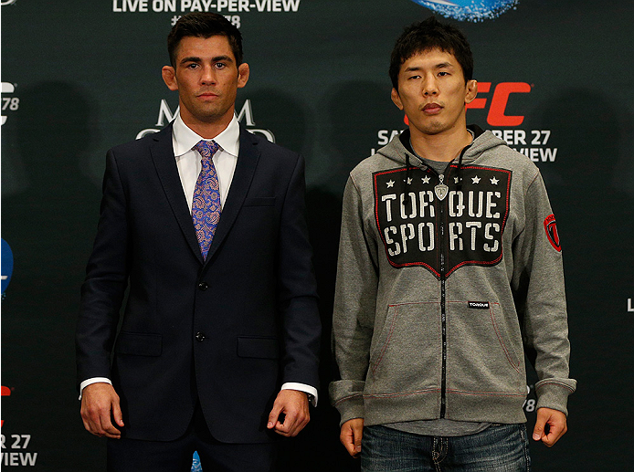 LAS VEGAS, NV - SEPTEMBER 25:  (L-R) Opponents Dominick Cruz and Takeya Mizugaki of Japan pose for photos during the UFC 178 Ultimate Media Day at the MGM Grand Hotel/Casino on September 25, 2014 in Las Vegas, Nevada. (Photo by Josh Hedges/Zuffa LLC/Zuffa