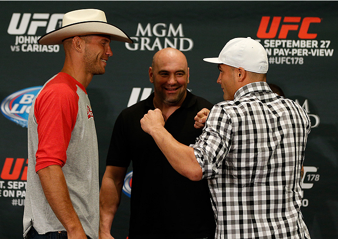 """LAS VEGAS, NV - SEPTEMBER 25:  (L-R) Opponents Donald """"Cowboy"""" Cerrone and Eddie Alvarez face off during the UFC 178 Ultimate Media Day at the MGM Grand Hotel/Casino on September 25, 2014 in Las Vegas, Nevada. (Photo by Josh Hedges/Zuffa LLC/Zuffa LLC via"""