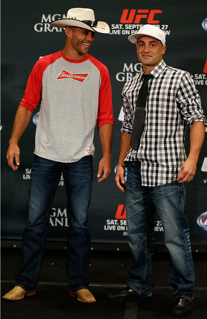 """LAS VEGAS, NV - SEPTEMBER 25:  (L-R) Opponents Donald """"Cowboy"""" Cerrone and Eddie Alvarez pose for photos during the UFC 178 Ultimate Media Day at the MGM Grand Hotel/Casino on September 25, 2014 in Las Vegas, Nevada. (Photo by Josh Hedges/Zuffa LLC/Zuffa"""