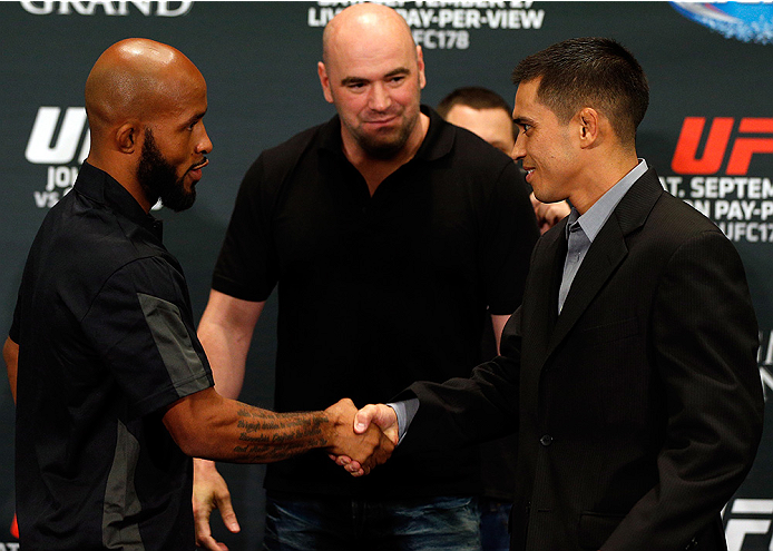 LAS VEGAS, NV - SEPTEMBER 25:  (L-R) Opponents Demetrious Johnson and Chris Cariaso shake hands during the UFC 178 Ultimate Media Day at the MGM Grand Hotel/Casino on September 25, 2014 in Las Vegas, Nevada. (Photo by Josh Hedges/Zuffa LLC/Zuffa LLC via G