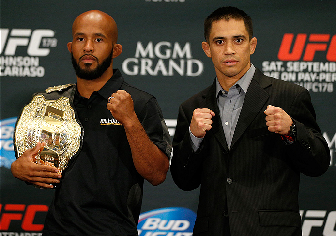 LAS VEGAS, NV - SEPTEMBER 25:  (L-R) Opponents Demetrious Johnson and Chris Cariaso pose for photos during the UFC 178 Ultimate Media Day at the MGM Grand Hotel/Casino on September 25, 2014 in Las Vegas, Nevada. (Photo by Josh Hedges/Zuffa LLC/Zuffa LLC v