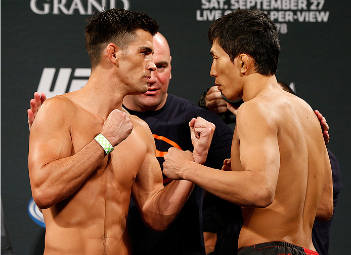 LAS VEGAS, NV - SEPTEMBER 26:  (L-R) Opponents Dominick Cruz and Takeya Mizugaki of Japan face off during the UFC 178 weigh-in at the MGM Grand Conference Center on September 26, 2014 in Las Vegas, Nevada. (Photo by Josh Hedges/Zuffa LLC/Zuffa LLC via Get