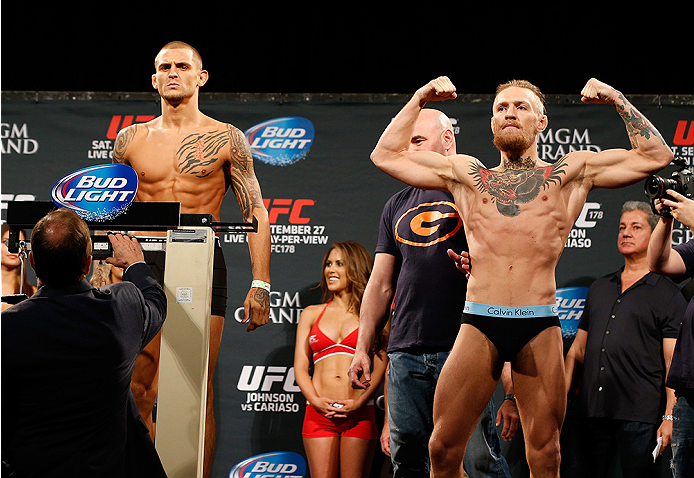 LAS VEGAS, NV - SEPTEMBER 26:  Dustin Poirier (L) stands on the scale attempting to make weight before his fight against Conor McGregor (R) of Ireland during the UFC 178 weigh-in at the MGM Grand Conference Center on September 26, 2014 in Las Vegas, Nevad
