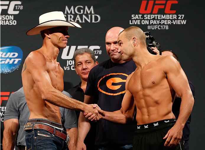 "LAS VEGAS, NV - SEPTEMBER 26:  (L-R) Opponents Donald ""Cowboy"" Cerrone and Eddie Alvarez shake hands during the UFC 178 weigh-in at the MGM Grand Conference Center on September 26, 2014 in Las Vegas, Nevada. (Photo by Josh Hedges/Zuffa LLC/Zuffa LLC via G"