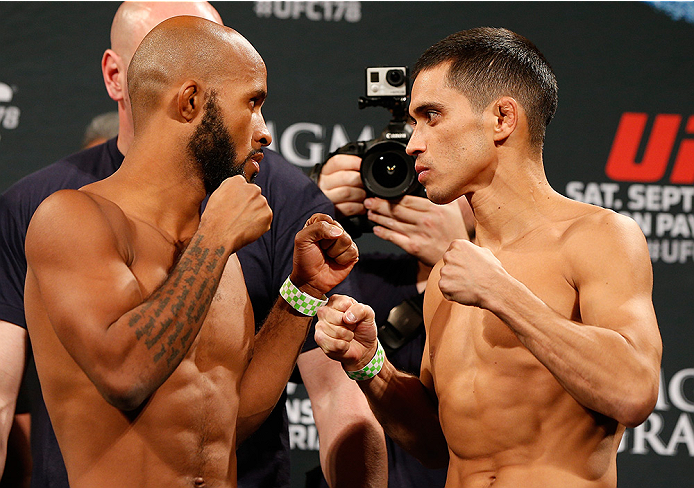 LAS VEGAS, NV - SEPTEMBER 26:  (L-R) Opponents Demetrious Johnson and Chris Cariaso face off during the UFC 178 weigh-in at the MGM Grand Conference Center on September 26, 2014 in Las Vegas, Nevada. (Photo by Josh Hedges/Zuffa LLC/Zuffa LLC via Getty Ima