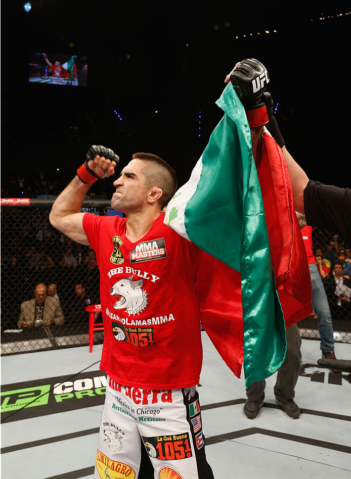 MEXICO CITY, MEXICO - NOVEMBER 15:  Ricardo Lamas celebrates his submission victory over Dennis Bermudez in their featherweight bout during the UFC 180 event at Arena Ciudad de Mexico on November 15, 2014 in Mexico City, Mexico.  (Photo by Josh Hedges/Zuf