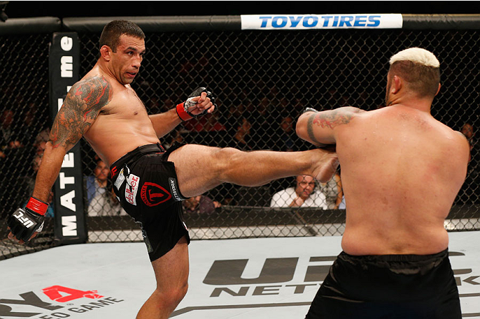 MEXICO CITY, MEXICO - NOVEMBER 15:  (L-R) Fabricio Werdum kicks Mark Hunt in their interim UFC heavyweight championship bout during the UFC 180 event at Arena Ciudad de Mexico on November 15, 2014 in Mexico City, Mexico.  (Photo by Josh Hedges/Zuffa LLC/Z