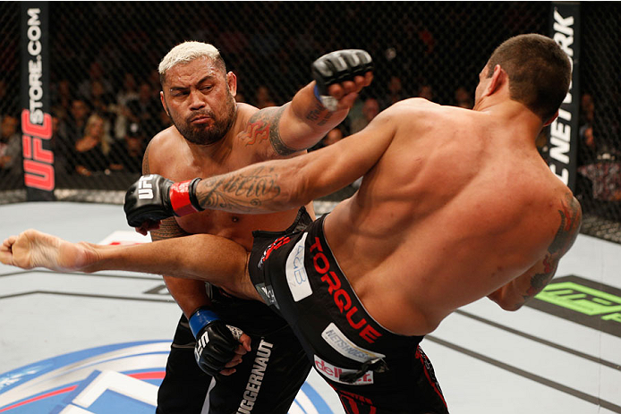 MEXICO CITY, MEXICO - NOVEMBER 15:  (R-L) Fabricio Werdum and Mark Hunt trade strikes in their interim UFC heavyweight championship bout during the UFC 180 event at Arena Ciudad de Mexico on November 15, 2014 in Mexico City, Mexico.  (Photo by Josh Hedges