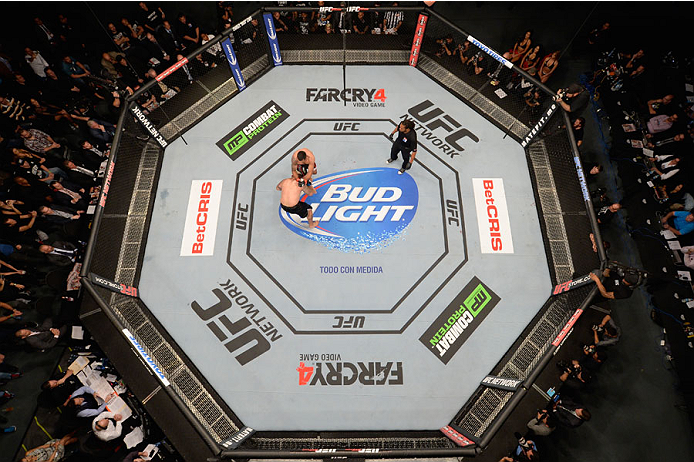 MEXICO CITY, MEXICO - NOVEMBER 15:  An overhead view of the Octagon as Fabricio Werdum (R) knocks out Mark Hunt in their interim UFC heavyweight championship bout during the UFC 180 event at Arena Ciudad de Mexico on November 15, 2014 in Mexico City, Mexi