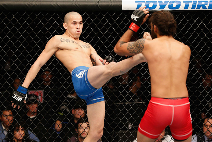 MEXICO CITY, MEXICO - NOVEMBER 15:  (L-R) Marlon Vera kicks Marco Beltra in their bantamweight bout during the UFC 180 event at Arena Ciudad de Mexico on November 15, 2014 in Mexico City, Mexico.  (Photo by Josh Hedges/Zuffa LLC/Zuffa LLC via Getty Images