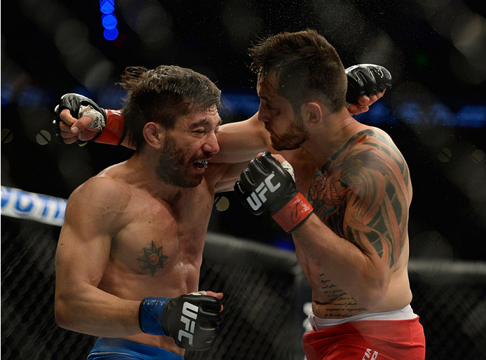 MEXICO CITY, MEXICO - NOVEMBER 15:  (L-R) Guido Cannetti exchanges punches with Henry Briones in their bantamweight bout during the UFC 180 event at Arena Ciudad de Mexico on November 15, 2014 in Mexico City, Mexico.  (Photo by Jeff Bottari/Zuffa LLC/Zuff