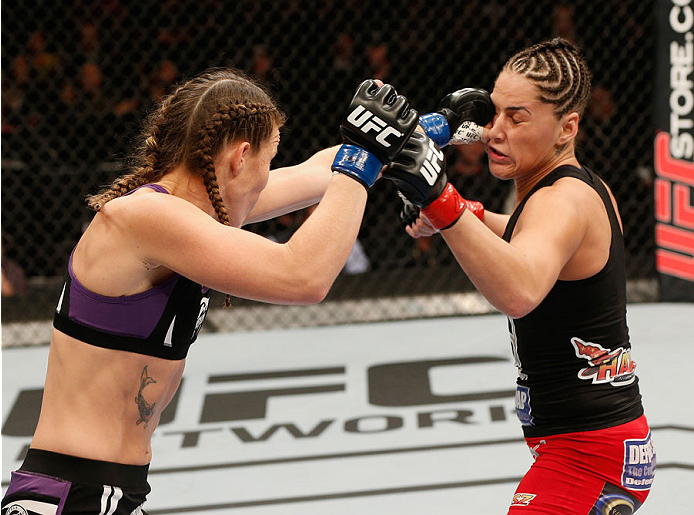 MEXICO CITY, MEXICO - NOVEMBER 15:  (L-R) Leslie Smith punches Jessica Eye in their women's bantamweight bout during the UFC 180 event at Arena Ciudad de Mexico on November 15, 2014 in Mexico City, Mexico.  (Photo by Josh Hedges/Zuffa LLC/Zuffa LLC via Ge