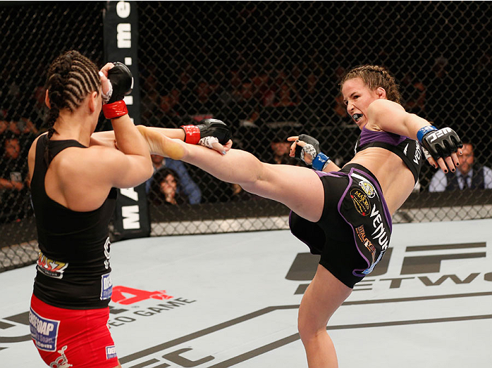 MEXICO CITY, MEXICO - NOVEMBER 15:  (R-L) Leslie Smith kicks Jessica Eye in their women's bantamweight bout during the UFC 180 event at Arena Ciudad de Mexico on November 15, 2014 in Mexico City, Mexico.  (Photo by Josh Hedges/Zuffa LLC/Zuffa LLC via Gett