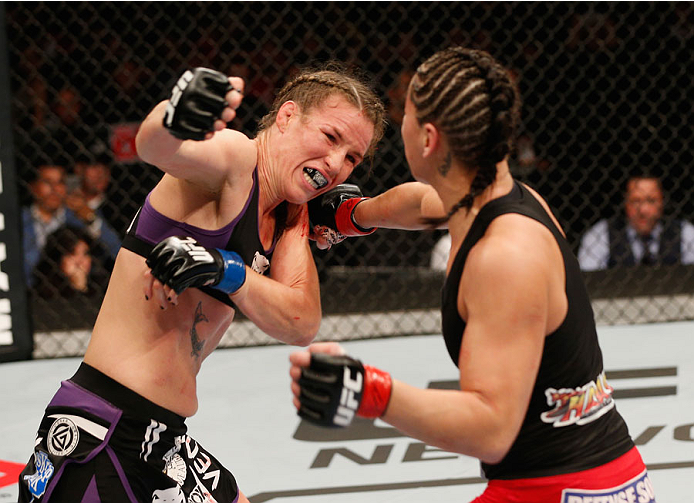 MEXICO CITY, MEXICO - NOVEMBER 15:  (R-L) Jessica Eye punches Leslie Smith in their women's bantamweight bout during the UFC 180 event at Arena Ciudad de Mexico on November 15, 2014 in Mexico City, Mexico.  (Photo by Josh Hedges/Zuffa LLC/Zuffa LLC via Ge