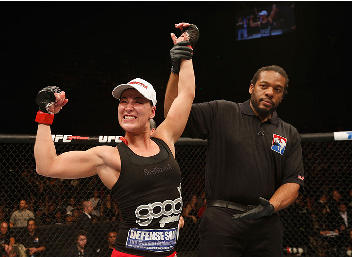 MEXICO CITY, MEXICO - NOVEMBER 15:  Jessica Eye celebrates her victory over Leslie Smith in their women's bantamweight bout during the UFC 180 event at Arena Ciudad de Mexico on November 15, 2014 in Mexico City, Mexico.  (Photo by Josh Hedges/Zuffa LLC/Zu