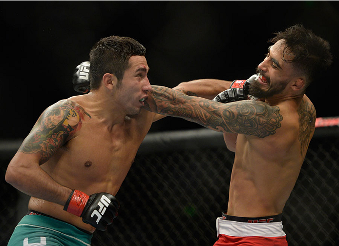 MEXICO CITY, MEXICO - NOVEMBER 15:  (R-L) Jose Quinonez exchanges punches with Alejandro Perez in their bantamweight bout during the UFC 180 event at Arena Ciudad de Mexico on November 15, 2014 in Mexico City, Mexico.  (Photo by Jeff Bottari/Zuffa LLC/Zuf