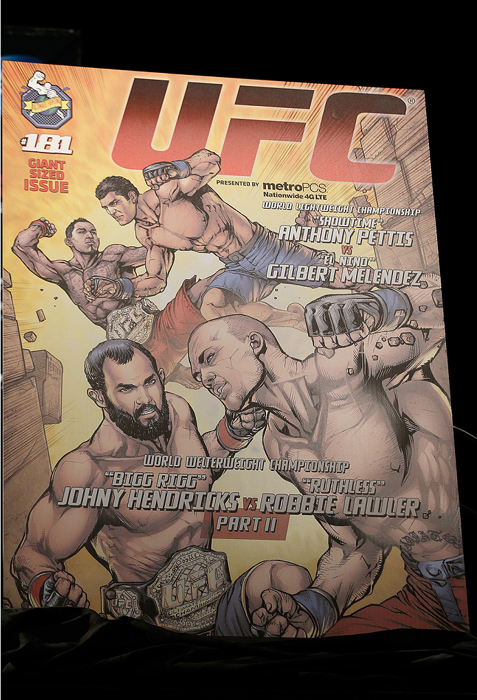 LAS VEGAS, NV - SEPTEMBER 26: The event poster featuring artwork by DC Comics is unveiled during the UFC 181 press conference at the MGM Grand Conference Center on September 26, 2014 in Las Vegas, Nevada. (Photo by Josh Hedges/Zuffa LLC/Zuffa LLC via Gett
