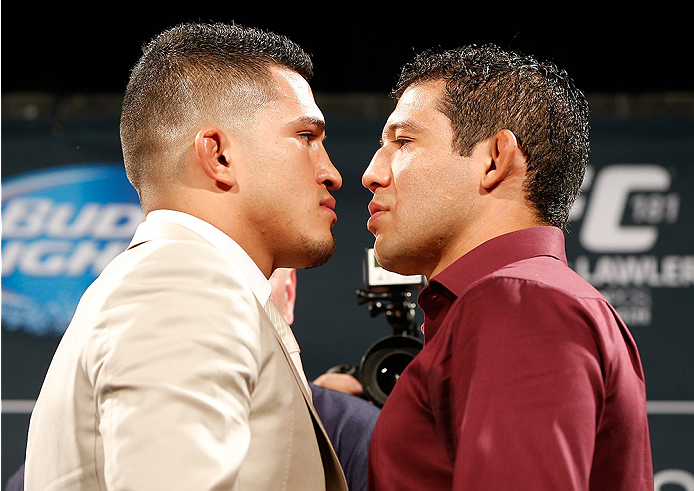 LAS VEGAS, NV - SEPTEMBER 26: (L-R) Opponents Anthony Pettis and Gilbert Melendez face off during the UFC 181 press conference at the MGM Grand Conference Center on September 26, 2014 in Las Vegas, Nevada. (Photo by Josh Hedges/Zuffa LLC/Zuffa LLC via Get