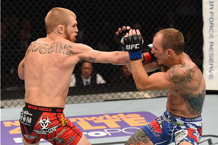 LAS VEGAS, NV - MAY 23:  (L-R) Justin Scoggins punches Joshua Sampo in their flyweight bout during the UFC 187 event at the MGM Grand Garden Arena on May 23, 2015 in Las Vegas, Nevada.  (Photo by Josh Hedges/Zuffa LLC/Zuffa LLC via Getty Images)