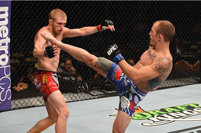 LAS VEGAS, NV - MAY 23:  (R-L) Joshua Sampo kicks Justin Scoggins in their flyweight bout during the UFC 187 event at the MGM Grand Garden Arena on May 23, 2015 in Las Vegas, Nevada.  (Photo by Josh Hedges/Zuffa LLC/Zuffa LLC via Getty Images)