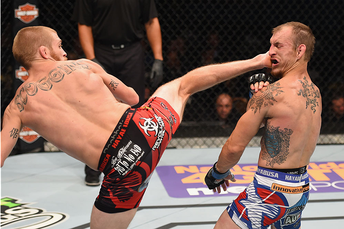 LAS VEGAS, NV - MAY 23:  (L-R) Justin Scoggins kicks Joshua Sampo in their flyweight bout during the UFC 187 event at the MGM Grand Garden Arena on May 23, 2015 in Las Vegas, Nevada.  (Photo by Josh Hedges/Zuffa LLC/Zuffa LLC via Getty Images)