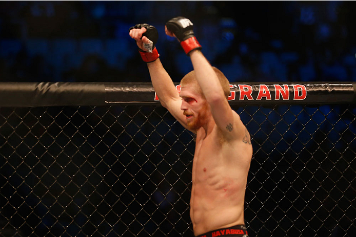 LAS VEGAS, NV - MAY 23:  Justin Scoggins celebrates his win over Joshua Sampo in their flyweight bout during the UFC 187 event at the MGM Grand Garden Arena on May 23, 2015 in Las Vegas, Nevada.  (Photo by Christian Petersen/Zuffa LLC/Zuffa LLC via Getty