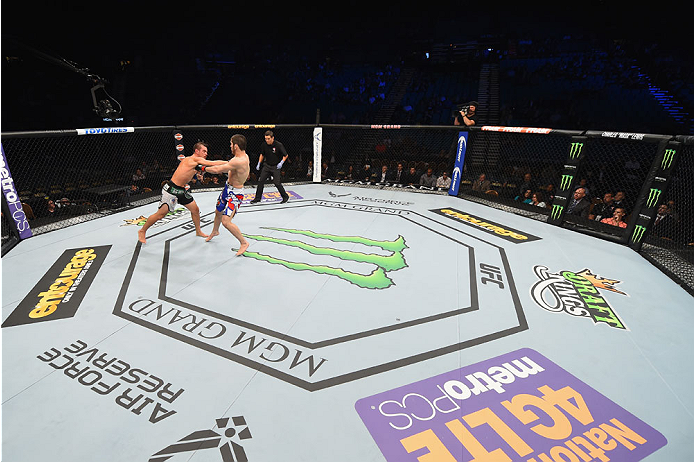 LAS VEGAS, NV - MAY 23:  (L-R) Leo Kuntz punches Islam Makhachev of Russia in their lightweight bout during the UFC 187 event at the MGM Grand Garden Arena on May 23, 2015 in Las Vegas, Nevada.  (Photo by Josh Hedges/Zuffa LLC/Zuffa LLC via Getty Images)