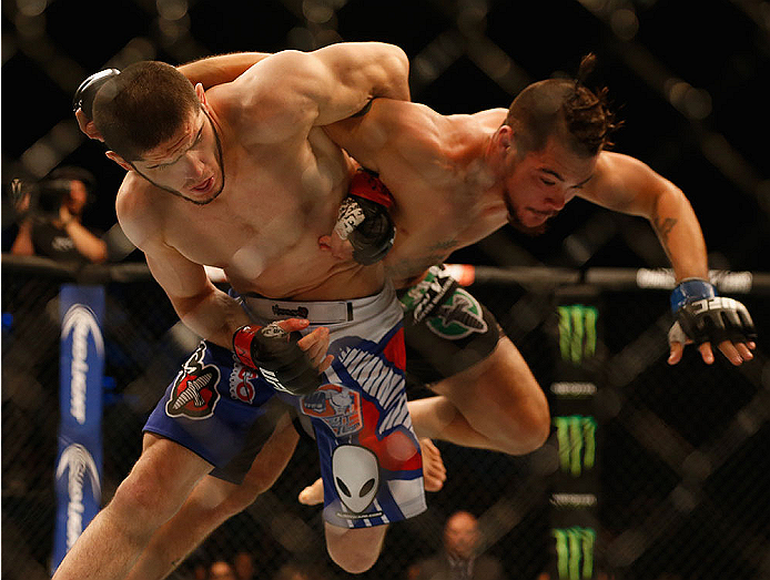 LAS VEGAS, NV - MAY 23:  (L-R) Islam Makhachev of Russia throws Leo Kuntz in their lightweight bout during the UFC 187 event at the MGM Grand Garden Arena on May 23, 2015 in Las Vegas, Nevada.  (Photo by Christian Petersen/Zuffa LLC/Zuffa LLC via Getty Im