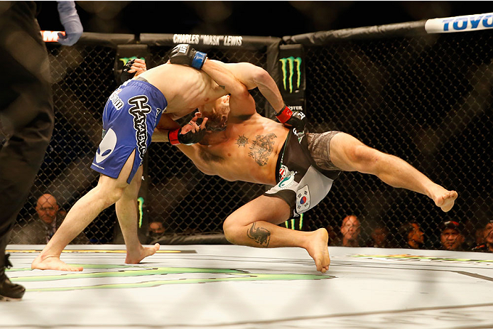 LAS VEGAS, NV - MAY 23:  Islam Makhachev of Russia (blue shorts) slams Leo Kuntz to the mat in their lightweight bout during the UFC 187 event at the MGM Grand Garden Arena on May 23, 2015 in Las Vegas, Nevada.  (Photo by Christian Petersen/Zuffa LLC/Zuff