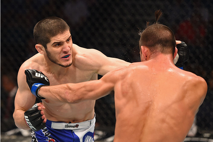 LAS VEGAS, NV - MAY 23:  (L-R) Islam Makhachev of Russia punches Leo Kuntz in their lightweight bout during the UFC 187 event at the MGM Grand Garden Arena on May 23, 2015 in Las Vegas, Nevada.  (Photo by Josh Hedges/Zuffa LLC/Zuffa LLC via Getty Images)