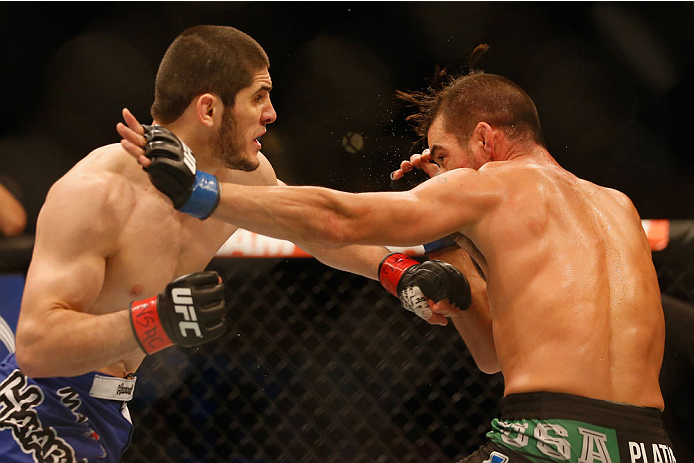 LAS VEGAS, NV - MAY 23:  (L-R) Islam Makhachev of Russia punches Leo Kuntz in their lightweight bout during the UFC 187 event at the MGM Grand Garden Arena on May 23, 2015 in Las Vegas, Nevada.  (Photo by Christian Petersen/Zuffa LLC/Zuffa LLC via Getty I