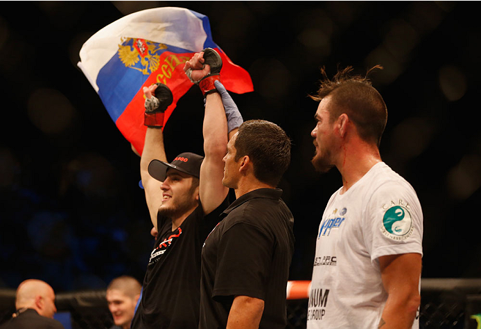 LAS VEGAS, NV - MAY 23:  Islam Makhachev of Russia (left) reacts to his victory over Leo Kuntz (right) in their lightweight bout during the UFC 187 event at the MGM Grand Garden Arena on May 23, 2015 in Las Vegas, Nevada.  (Photo by Christian Petersen/Zuf