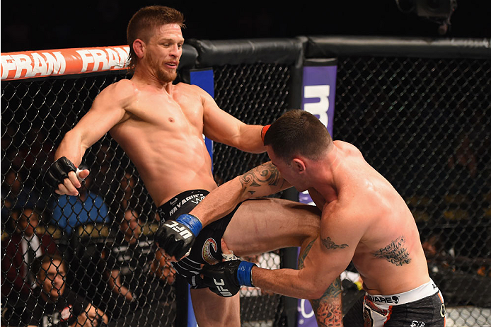 LAS VEGAS, NV - MAY 23:  (L-R) Mike Pyle kicks Colby Covington in their welterweight bout during the UFC 187 event at the MGM Grand Garden Arena on May 23, 2015 in Las Vegas, Nevada.  (Photo by Josh Hedges/Zuffa LLC/Zuffa LLC via Getty Images)
