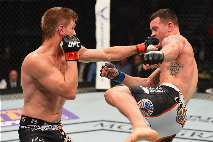 LAS VEGAS, NV - MAY 23:  (L-R) Mike Pyle punches Colby Covington in their welterweight bout during the UFC 187 event at the MGM Grand Garden Arena on May 23, 2015 in Las Vegas, Nevada.  (Photo by Josh Hedges/Zuffa LLC/Zuffa LLC via Getty Images)