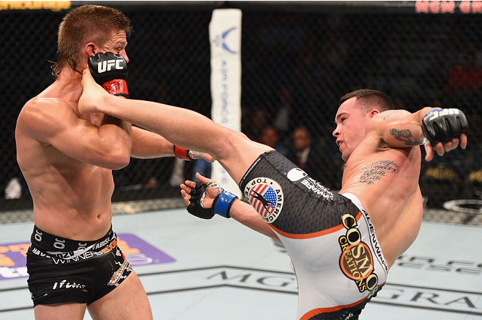 LAS VEGAS, NV - MAY 23:  (R-L) Colby Covington kicks Mike Pyle in their welterweight bout during the UFC 187 event at the MGM Grand Garden Arena on May 23, 2015 in Las Vegas, Nevada.  (Photo by Josh Hedges/Zuffa LLC/Zuffa LLC via Getty Images)