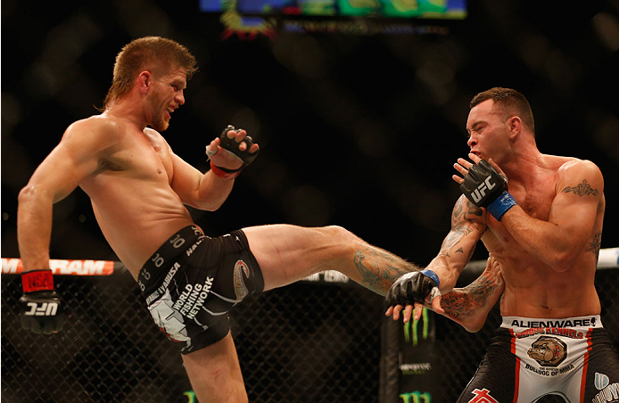 LAS VEGAS, NV - MAY 23:  (L-R) Mike Pyle kicks Colby Covington in their welterweight bout during the UFC 187 event at the MGM Grand Garden Arena on May 23, 2015 in Las Vegas, Nevada.  (Photo by Christian Petersen/Zuffa LLC/Zuffa LLC via Getty Images)