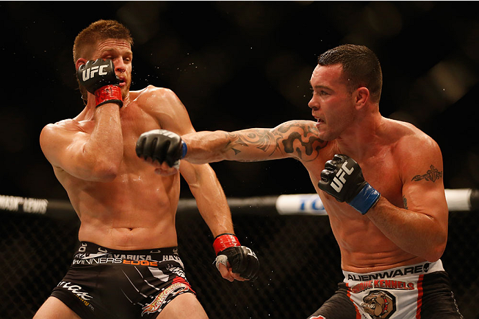 LAS VEGAS, NV - MAY 23:  (R-L) Colby Covington punches Mike Pyle in their welterweight bout during the UFC 187 event at the MGM Grand Garden Arena on May 23, 2015 in Las Vegas, Nevada.  (Photo by Christian Petersen/Zuffa LLC/Zuffa LLC via Getty Images)