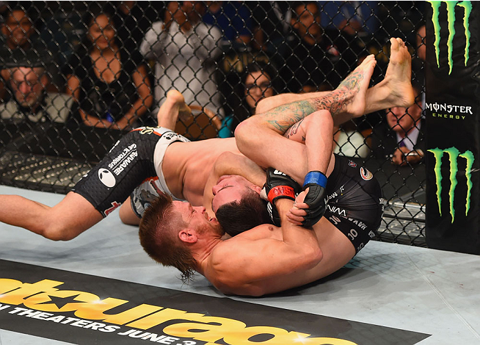 LAS VEGAS, NV - MAY 23:  Mike Pyle (bottom) attempts to submit Colby Covington in their welterweight bout during the UFC 187 event at the MGM Grand Garden Arena on May 23, 2015 in Las Vegas, Nevada.  (Photo by Josh Hedges/Zuffa LLC/Zuffa LLC via Getty Ima