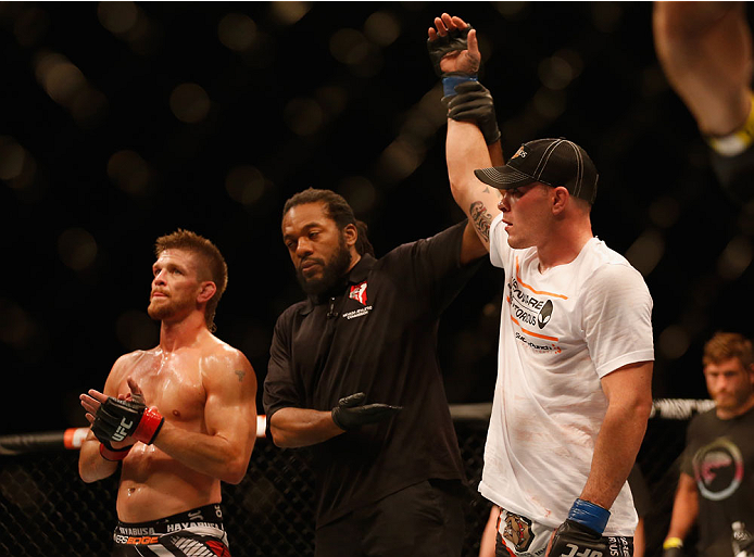 LAS VEGAS, NV - MAY 23:  Colby Covington (right) is declared the winner over Mike Pyle (left) in their welterweight bout during the UFC 187 event at the MGM Grand Garden Arena on May 23, 2015 in Las Vegas, Nevada.  (Photo by Christian Petersen/Zuffa LLC/Z