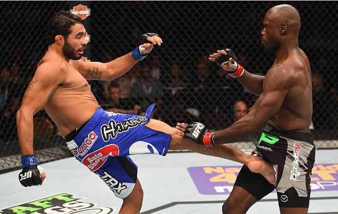 LAS VEGAS, NV - MAY 23:  (L-R) Rafael Natal of Brazil kicks Uriah Hall in their middleweight bout during the UFC 187 event at the MGM Grand Garden Arena on May 23, 2015 in Las Vegas, Nevada.  (Photo by Josh Hedges/Zuffa LLC/Zuffa LLC via Getty Images)