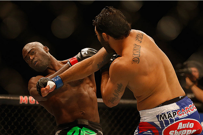 LAS VEGAS, NV - MAY 23:  (R-L) Rafael Natal of Brazil punches Uriah Hall in their middleweight bout during the UFC 187 event at the MGM Grand Garden Arena on May 23, 2015 in Las Vegas, Nevada.  (Photo by Christian Petersen/Zuffa LLC/Zuffa LLC via Getty Im