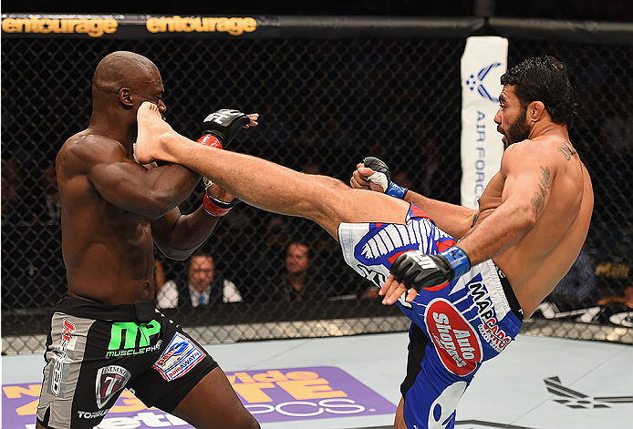 LAS VEGAS, NV - MAY 23:  (R-L) Rafael Natal of Brazil kicks Uriah Hall in their middleweight bout during the UFC 187 event at the MGM Grand Garden Arena on May 23, 2015 in Las Vegas, Nevada.  (Photo by Josh Hedges/Zuffa LLC/Zuffa LLC via Getty Images)