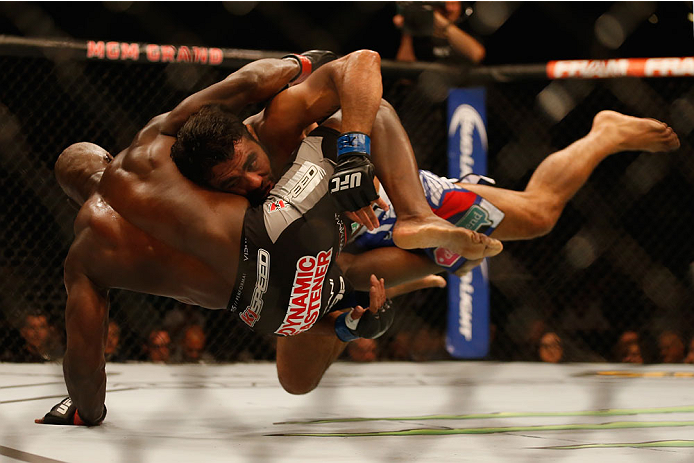 LAS VEGAS, NV - MAY 23:  (R-L) Rafael Natal of Brazil takes down Uriah Hall in their middleweight bout during the UFC 187 event at the MGM Grand Garden Arena on May 23, 2015 in Las Vegas, Nevada.  (Photo by Christian Petersen/Zuffa LLC/Zuffa LLC via Getty