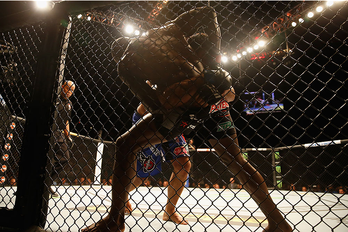 LAS VEGAS, NV - MAY 23:  Rafael Natal of Brazil and Uriah Hall (front) grapple against the Octagon fence in their middleweight bout during the UFC 187 event at the MGM Grand Garden Arena on May 23, 2015 in Las Vegas, Nevada.  (Photo by Christian Petersen/