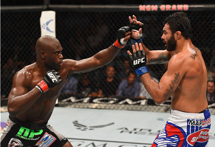 LAS VEGAS, NV - MAY 23:  (L-R) Uriah Hall punches Rafael Natal of Brazil in their middleweight bout during the UFC 187 event at the MGM Grand Garden Arena on May 23, 2015 in Las Vegas, Nevada.  (Photo by Josh Hedges/Zuffa LLC/Zuffa LLC via Getty Images)