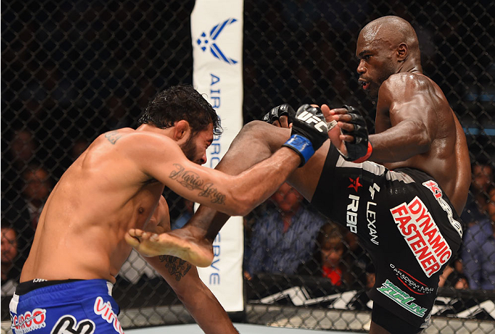 LAS VEGAS, NV - MAY 23:  (R-L) Uriah Hall kicks Rafael Natal of Brazil in their middleweight bout during the UFC 187 event at the MGM Grand Garden Arena on May 23, 2015 in Las Vegas, Nevada.  (Photo by Josh Hedges/Zuffa LLC/Zuffa LLC via Getty Images)